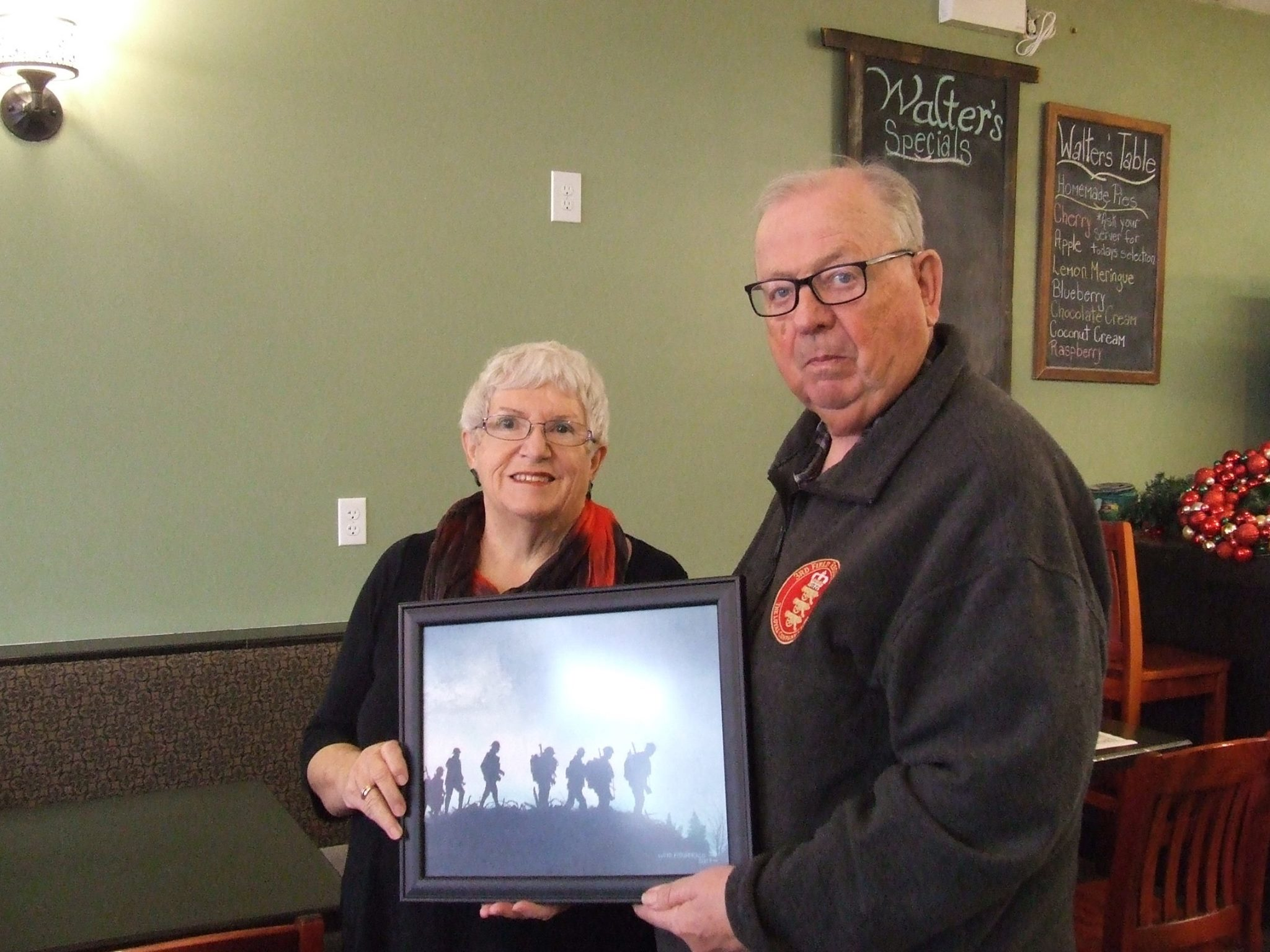 1st Prize Winner in our recent fund-raiser, Gib Anderson, is presented an original painting by Loyd Fitzgerald, by Woodstock Unit #95 ANAVETS Service Officer Bob MacFarlane. Congrats Gib!!