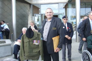 Frank Godon, Jr. presenting his Dad's uniform and medals to the Juno Beach Centre. Frank, Sr. went ashore with the Winnipeg Rifles.